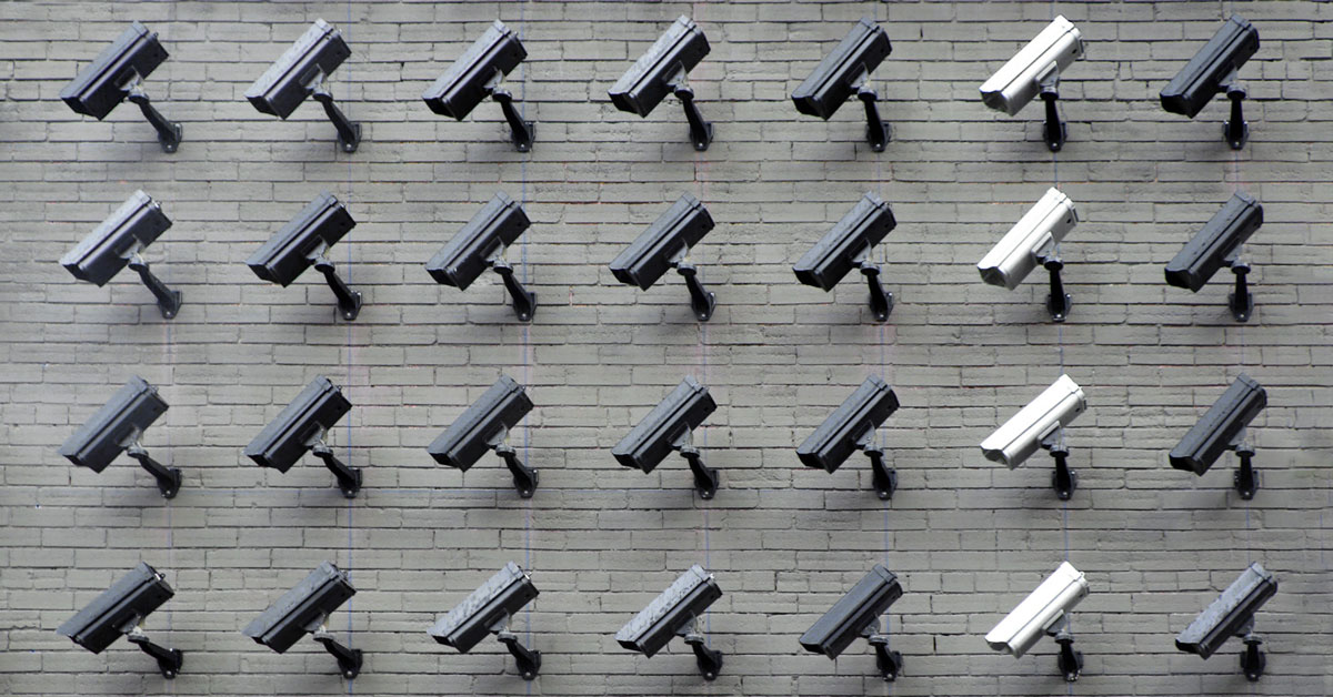 a wall with security cameras