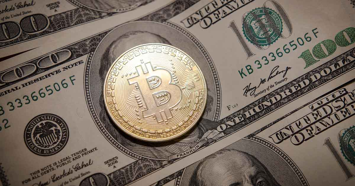 Image of a Bitcoin behind USD paper