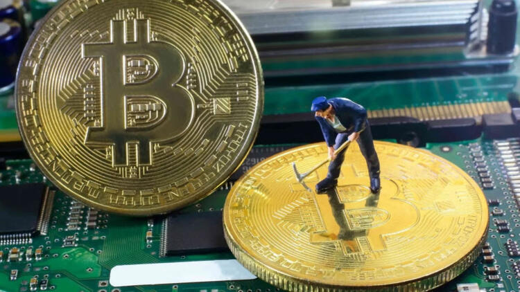 Bitcoin being mined by a small toy of a man with a pickaxe